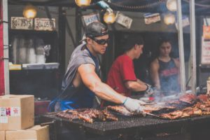 Man cooking barbecue at a food festival