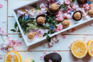 Tray of food with flowers and lemons